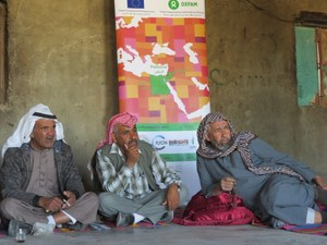 A group of Palestinian Bedouins in the Southern West Bank attending a meeting with the project team to discuss their communities' needs and priorities.